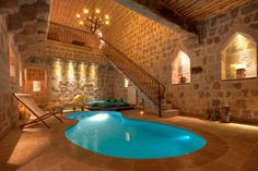Whoa now THIS is an indoor swimming pool. The stone walls ... OH!