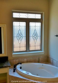 This stained glass window fits perfect in this bathroom. Description from scottishstainedglass.com. I searched for this on bing.com/images