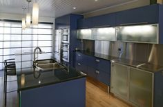 Modern kitchen with blue and stainless