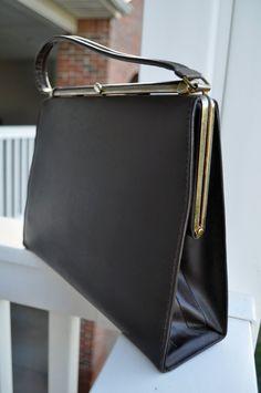 Classic Retro Dark Brown Handbag with tan interior  Leather exterior and vinyl interior  Designer: Spilene (made in the U.S.A.)  $25