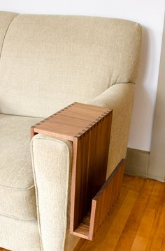 SOFA ARM TABLE BY WILBUR DAVIS STUDIOS  Entertain and relax in comfort with your favorite beverage and book close at hand. This sofa arm wrap is the