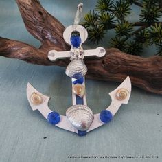 Silver and Bllue anchor Sea shell ornament by CarmelasCoastalCraft, $5.50
