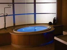 Chromatherapy tubs are integrated with colored lights to create a therapeutic experience.