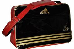 adidas  Boxing, MMA, Taekwondo, Karate Sports Bag Holdall - Black/Red/Gold (Boxing) No description (Barcode EAN = 9002920130813). http://www.comparestoreprices.co.uk/boxing-equipment/adidas-boxing-mma-taekwondo-karate-sports-bag-holdall--black-red-gold-boxing-.asp