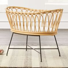 Shop Rattan Bassinet.  Our Rattan Bassinet is a statement-making essential for your first steps into parenthood.  Trim, exceptionally durable legs made from powder-coated iron elevate a beautiful natural rattan frame with gently sloping curves.