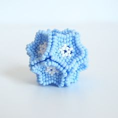 Our flower beaded bead tutorial includes all the instructions you need to make a bead that looks like a cluster of flowers.