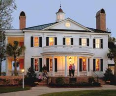 Traditional colonial home with a gracious entrance porch and double side porches - would be fantastic in Charleston or another Southern coastal town