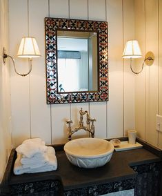 Sconces with homemade basin sink- powder room.