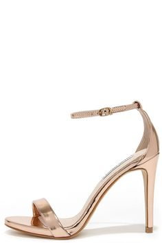 Wherever you go the Steve Madden Stecy Rose Gold Ankle Strap Heels will step up your style! Faux rose gold leather shapes a single sole heel with ankle strap.
