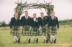 Kath & Matt's Wedding, photo by: photobailey Cornish tartan groomsmen cornwall wedding by the sea sunflowers yellow corsage buttonhole driftwood wood arch