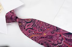 This is a gorgeous Rhinestone necktie handmade and designed by top brand name Mila Schon. Presenting an beautiful purple Paisley design sparkling with white, orange, red, blue, silver Rhinestones.