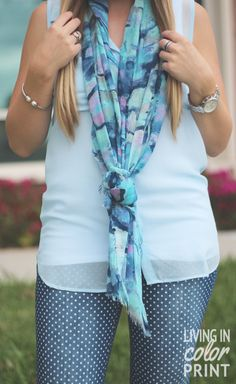 great accessories play up any outfit. This printed scarf and silver jewelry really add a nice touch to the simple outfit