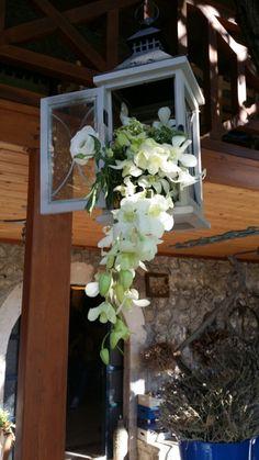 NB wedding in Lefkada Greece taverna hanging lanterns with cascading flowers