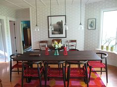 """Sneak Peek: A Massachusetts Farmhouse Where Color and Pattern Meet. """"My husband, Adrian, likes to joke that this table was practically the only piece of his furniture that made it into the house.  Wallpapering the entire dining room with this abstract geometric paper from Sandpiper Studios felt a little risky but I was so thrilled with the final outcome. The photograph on the back wall was taken by our good friend Edward Judice with a pinhole camera."""" #sneakpeek"""