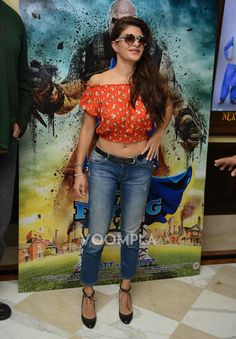 Jacqueline showing belly button in jeans and crop top