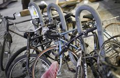Bicycles still locked to a bike post recovered from the World Trade Center disaster site sit inside Hanger 17 at New York's John F. Kennedy International Airport June 16.