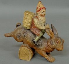 German Victorian painted plaster figural group of a rabbit being ridden by an elf