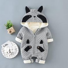* Panda design<br /> * Non-detachable hood<br /> * Front zipper<br /> * Bottom snaps<br /> * Cozy and warm<br /> * Material: 93% Cotton, 7% Spandex<br /> * Machine wash, tumble dry<br /> * Imported<br /> <br /> Your baby looks super sweet in this trendy jumpsuit featuring panda design and convenient snap closure for easy diapering.