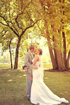 A kiss under the trees. Photo by Benjamin. #weddingphotographerminneapolis #minnesotawedding
