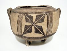 Pottery pyxis or jar on three looped legs in Bichrome ware.       Cypro-Geometric 800BC-600BC (circa)