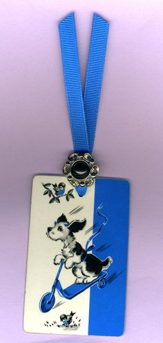 Handmade SCOOTER DOG Bookmark from Vintage Playing Card & Button with Grosgrain Ribbon. $4.00, via Etsy.