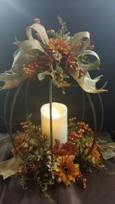 Designer iron pumpkin candle holder decorated for fall. Designed by Twigs. This is designed to use with a fireless candle only. SOLD - Fall Candles - Ideas of Fall Candles Fall Lanterns, Christmas Lanterns, Fall Candles, Lanterns Decor, Thanksgiving Decorations, Christmas Decorations, Rustikalen Shabby Chic, Fall Floral Arrangements, Rustic Fall Decor