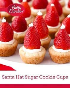 Santa Hat Sugar Cookie Cups Sweet and simple sugar cookie cups, made easy with Betty Crocker™ cookie mix, get all dressed up for the season with vanilla frosting and fresh strawberries. Christmas Party Food, Xmas Food, Christmas Appetizers, Christmas Sweets, Christmas Cooking, Holiday Desserts, Holiday Baking, Holiday Recipes, Christmas Wood