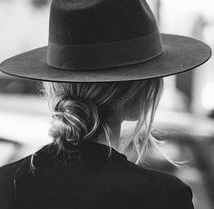 flat brimmed hat with low bun