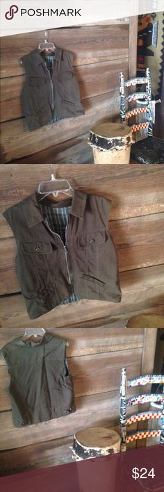 Vintage Utility Vest Perfect condition! No size tag. Fits like a M/L. Lined with a plaid wool like material. Made by St. John's Bay Vintage Jackets & Coats Vests