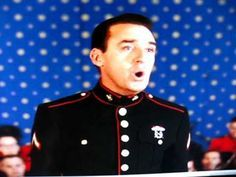 The Impossible Dream sung by Jim Nabors. He performed this song on the Andy Griffith show as Gomer Pyle who was in the Marine Corp.