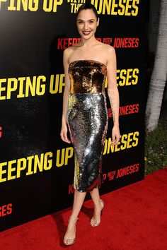 Gal Gadot said it with sequins in a strapless Dolce & Gabbana dress for the premiere of Keeping Up With The Joneses in Los Angeles.