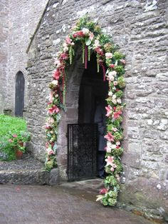 church archway decorated with flowers