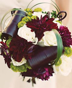 wedding bouquet  Bouquet of dahlias, button mums, roses, aspidistra leaves, lily grass, and uluhe ferns