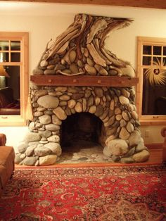 Stone and driftwood fireplace, truly a work of art!  By Ackerman Studios of Santa Cruz, CA, USA.  These guys are amazing.