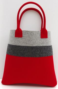 Wonderful tote, perfect for shopping or to fit everyday belongings in. I combined the red with light grey and added charcoal to have another contrast. Measurements: 35cm/ 14 x 35cm/ 14 x 8/ 3 Fabric: red and light grey wool felt 3mm, charcoal wool felt 1.5mm Please contact me, if you have any questions. I ship via normal post from France. Should you wish a tracked or express delivery, please contact me and I will arrange that for you. Please check my policies for further information:...