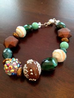 Shades of turquoise and chocolate brown beaded by TheFloralFern, $12.00
