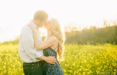 Engagement Photos- engaged couple in a field of yellow flowers near West Chester, PA