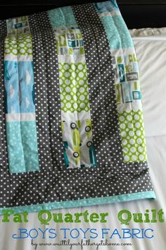 Fat Quarter Boys Toys Quilt via www.waittilyourfathergetshome.com #quilt #sewing