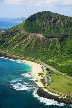 Aerial of Koko Crater and Sandy Beach Park – Oahu, Hawaii.....I actually got to walk thru a volcano the air blows thru the tunel to the old WWII bunker...the view from the top was spectacular !!!!