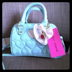 Betsey Johnson Mini barrel Mint handbag Betsey Johnson mini barrel spice handbag. Removable Crossbody strap. Features a white bow with leather trim and pink jeweled heart trimmed in gold tone detailing. Mint body with heart quilting pattern on the front and back. NWT. No trades. Betsey Johnson Bags