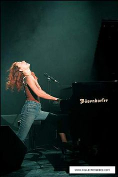 Tori Amos - 1994. One of the most gifted, passionate, intelligent, and beautiful performers to ever perform on stage. And this photo says it all.