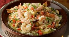 Carino's Shrimp Scampi  Copycat Recipe   Serves 2   1 cup sliced mushrooms  1 teaspoon sliced basil  9 raw shrimp  1/2 cup lemon butter ...