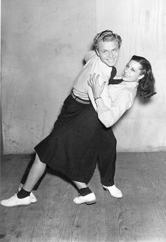 I am noticing a white shoe dark sock theme...new york--lindy hoppers 1940s. Lindy hop swing dance