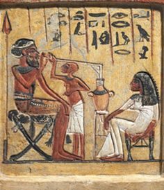 NOTICE THE LAD TO THE RIGHT HAS THE AFRO AND IS CARRYING THE GRAPES FOR HIS MASTER THE EGYPTIAN BOY WEARING AN HEADDRESS WHICH WAS AN EGYPTIAN CUSTOM