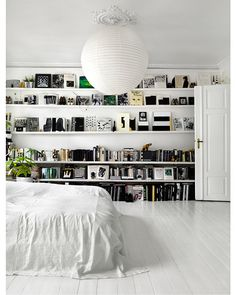 bedroom shelves ... the incredibly cool monochrome themed studio and home of Danish artist Tenka Gamelgaard