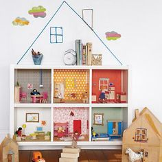 sideways bookcase or 6 cubby doubles as a dollhouse... So nifty!!