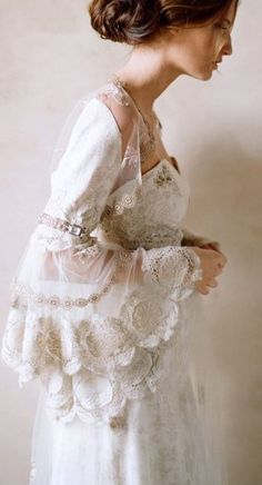A dramatic vintage wedding dress with beautiful lace details