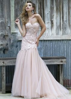 Jazz up your night of glamour with the extravagant details comprising the fit and flare silhouette of Sherri Hill 11155 evening dress. The nude lining stands in striking contrast with the pastel overlay, further adorned with a luxurious stretch of floral lace appliques around the bodice. The strapless sweetheart neckline crowns the corset styled bodice, tapered through the hips with a series of external boning.