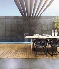 Nuevo estilo para una terraza con Trafic Cemento Antracita 59,6x59,6 de Porcelanosa