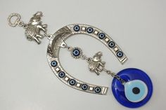 Evil eye wall hanging horseshoe and elephant with by EvilEyeHome